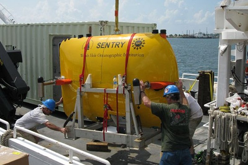 underwater vehicle being loaded on ship