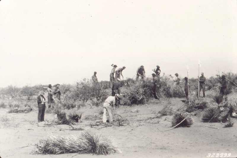 historic image sepia toned scientists working in desert