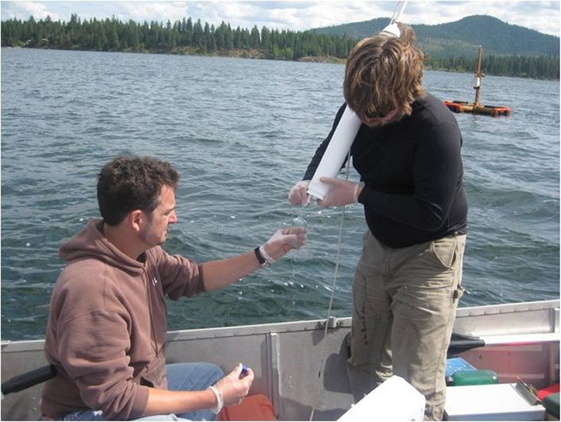 researchers sample water at north twin lake