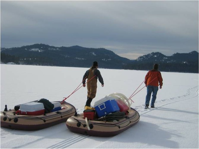 graduate students haul mercury monitoring gear to north twin lake
