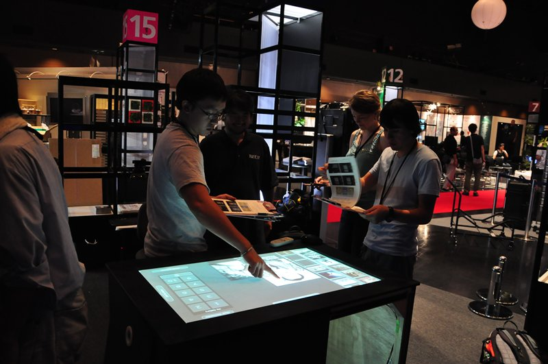 an interactive museum exhibit uses a touch table