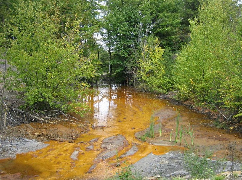 acid mine drainage seeps into water in cambria, pennsylvania