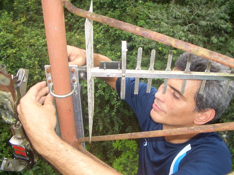 a researcher installs a recording station in costa rica