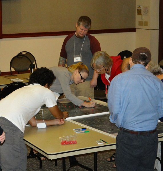 participants discuss potential locations for wind energy projects