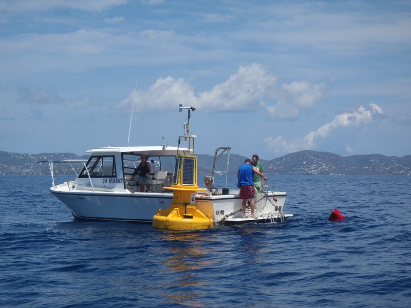researchers deploy a marine data buoy