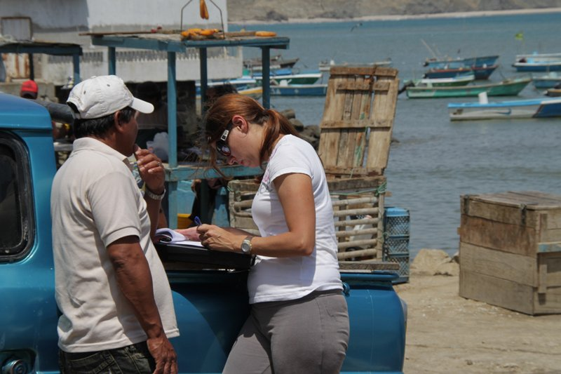 a field assistant conducts a survey on fishing practices